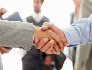 stock-photo-9370639-business-colleagues-shaking-hands